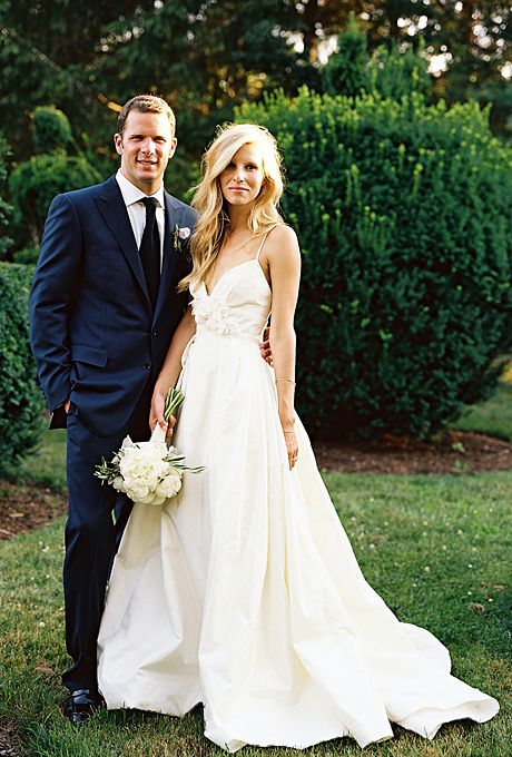 effortlessly chic ivory wedding dress with spaghetti straps and floral detailing