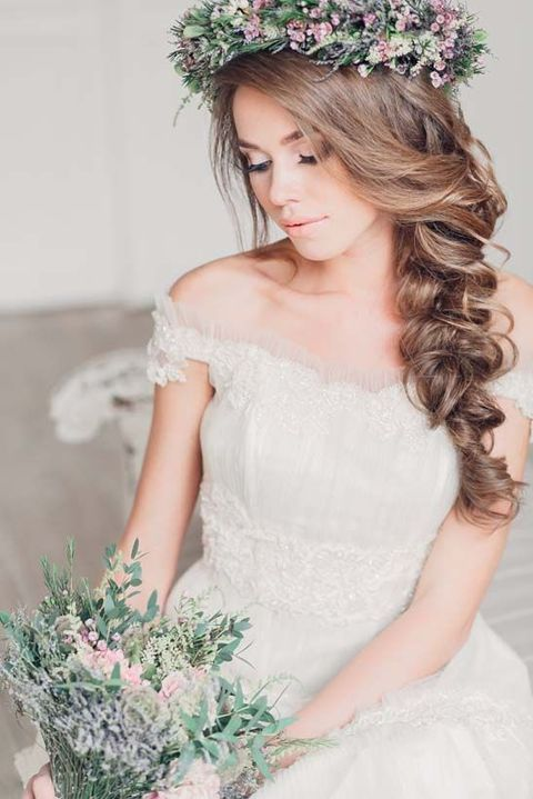 make your owwn messy and curly braid and crown it all with a fresh flower crown
