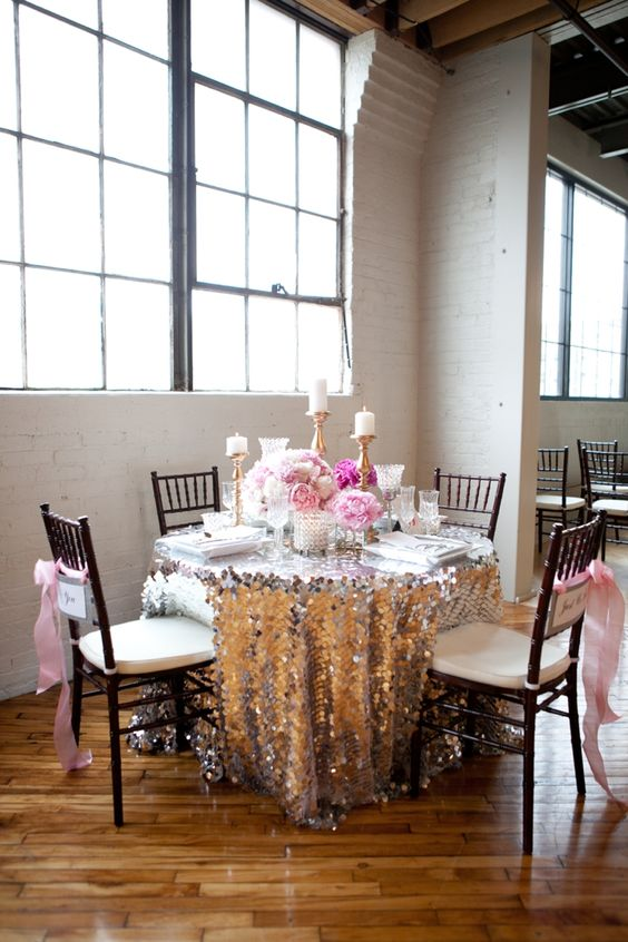 silver and pink table setting with pink flowers