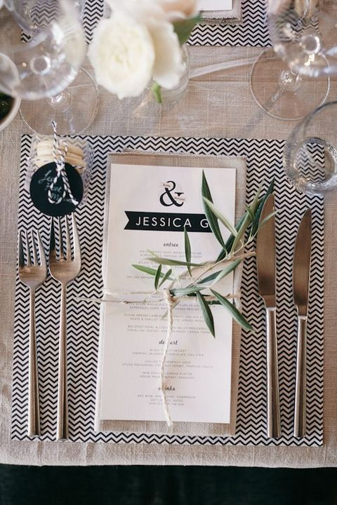black and white placemat, greenery and flowers for a modern table setting