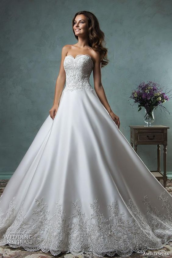embroidered bodice and skirt look cool on this satin gown