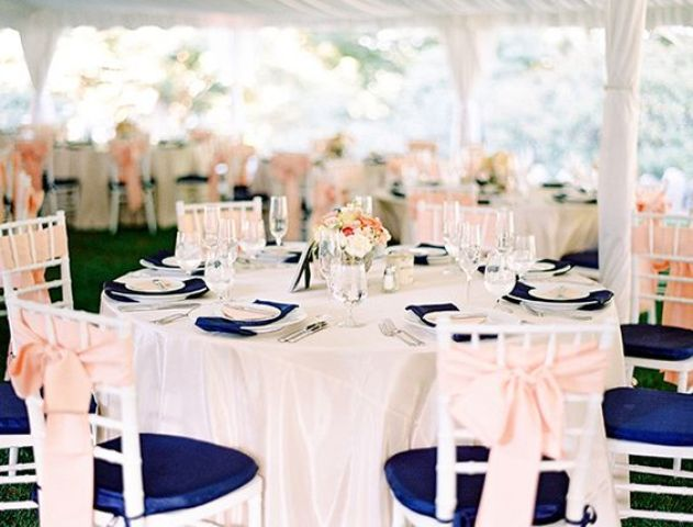 navy chairs and napkins, blush bows and flowers