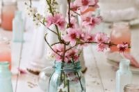 23 cherry blossom branches can serve as pretty centerpieces