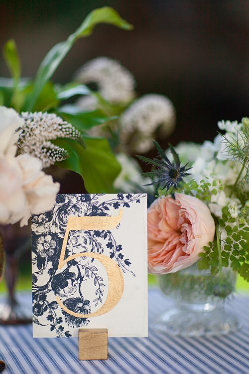 navy and gold table number, blush flowers