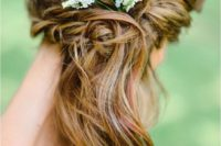 24 boho woven side swept wavy hair with baby's breath