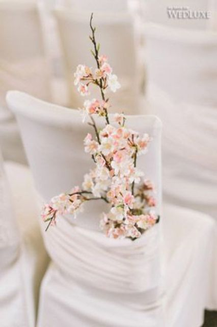 cherry blossoms attached to a chair is a great idea to decorate it