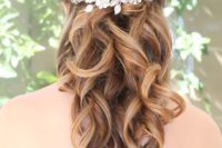24 curled half updo with a headpiece