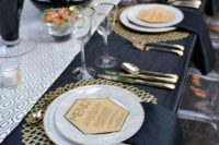 24 elegant gold laser cut placemats, black tablecloth and geo details for an art deco table