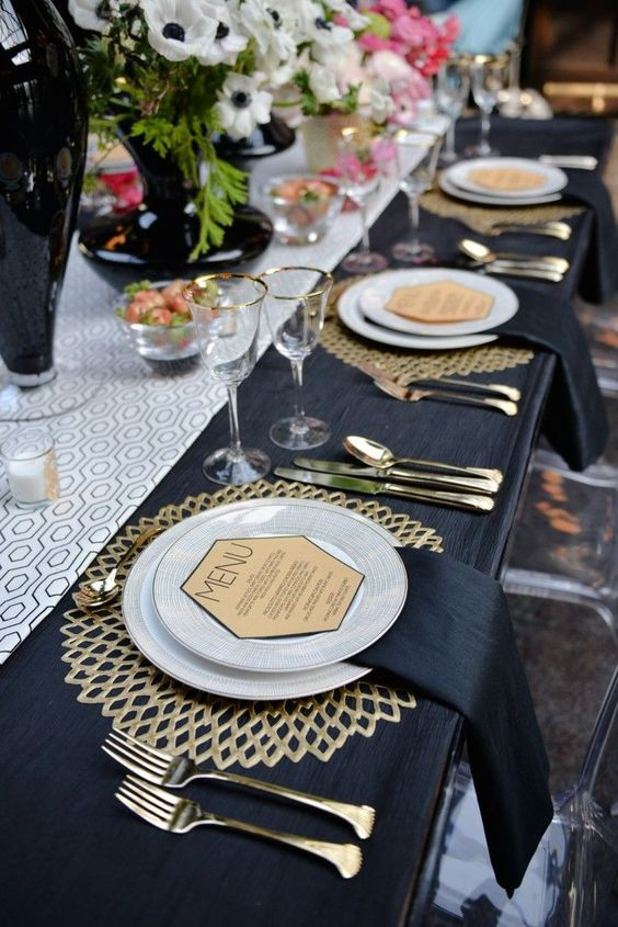 elegant gold laser cut placemats, black tablecloth and geo details for an art deco table