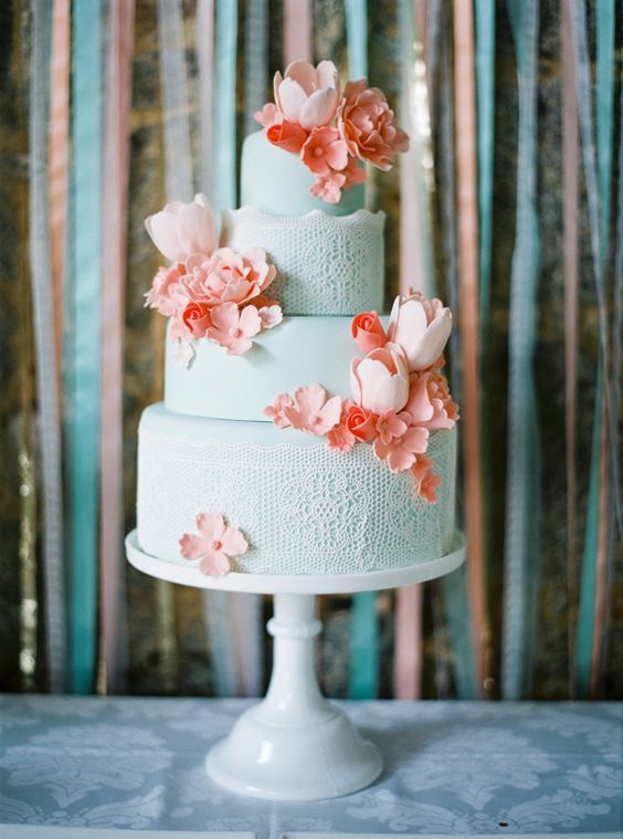 mint lace cake topped with peach sugar flowers