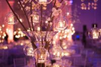 25 cherry blossom with hanging glass candle holders can make up an amazing centerpiece