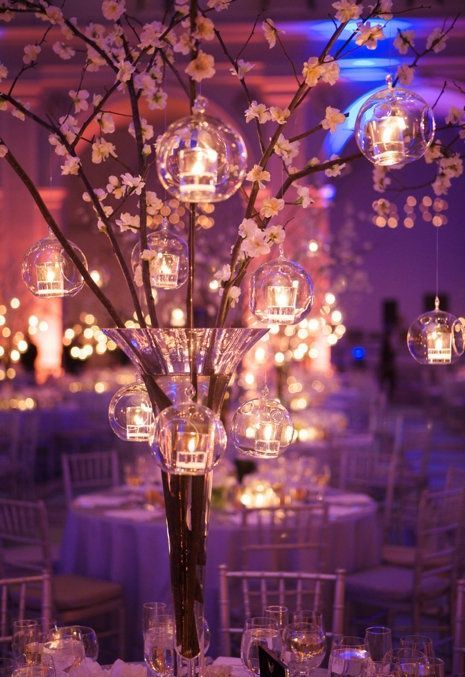 cherry blossom with hanging glass candle holders can make up an amazing centerpiece