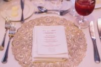 25 gold doily placemats make up the whole table decor
