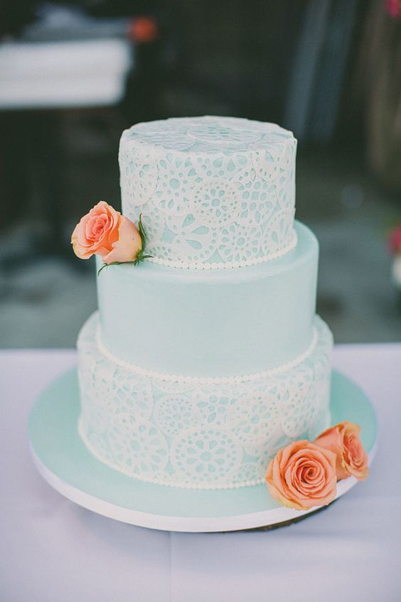 mint lace wedding cake decorated with peach roses