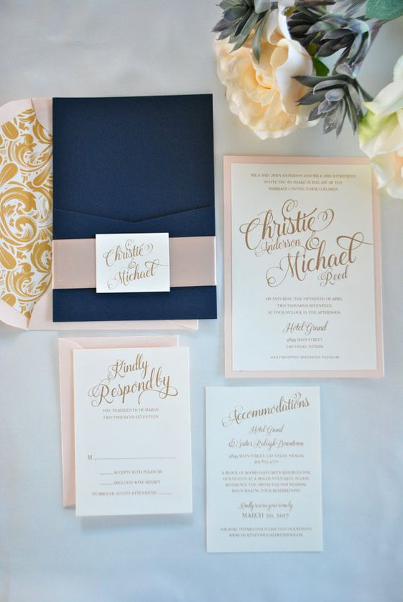 a navy envelope and blush invitations look amazing together