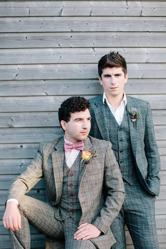 grooms in the same suits but of different colors - green and brown