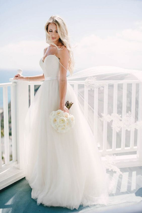 modern spaghetti strap wedding dress with a tulle skirt