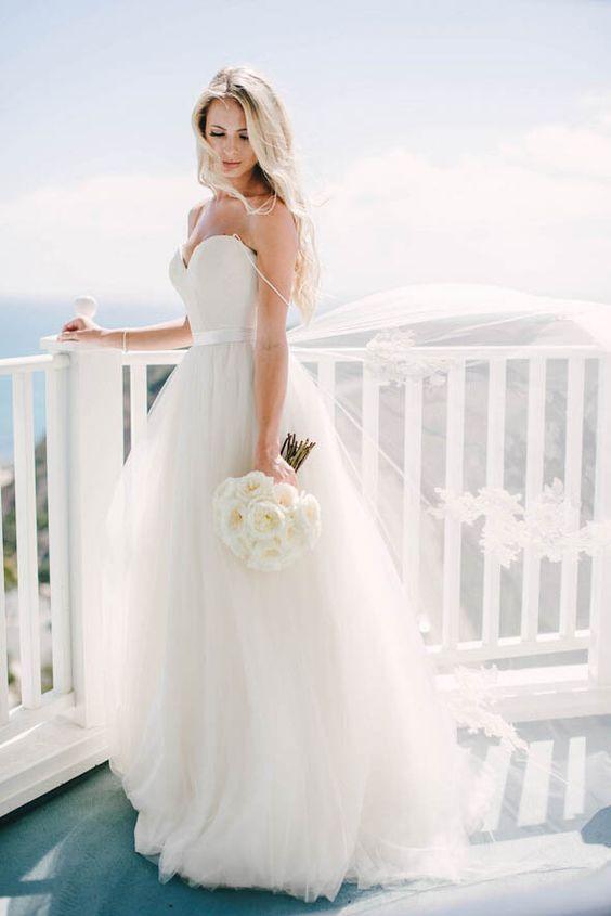 modern spaghetti strap wedding dress with a tulle skirt