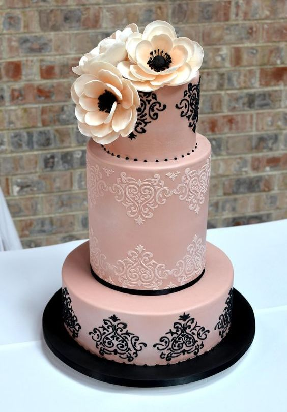 blush and black lace wedding cake with ivory flowers