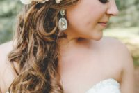 27 curly side swept hair can be beautifully accentuated with fresh flowers