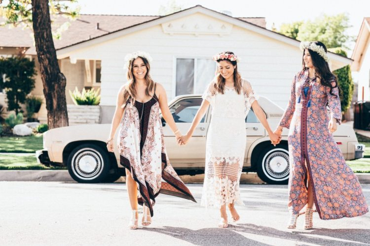 flowy boho gown with bold prints and floral crowns are amazing for such occasions