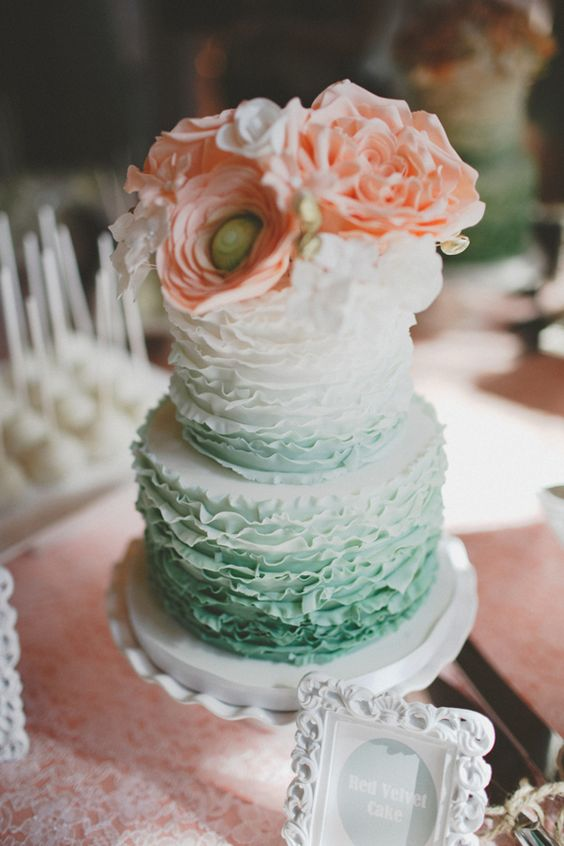 ruffle ombre mint wedding cake topped with peach flowers