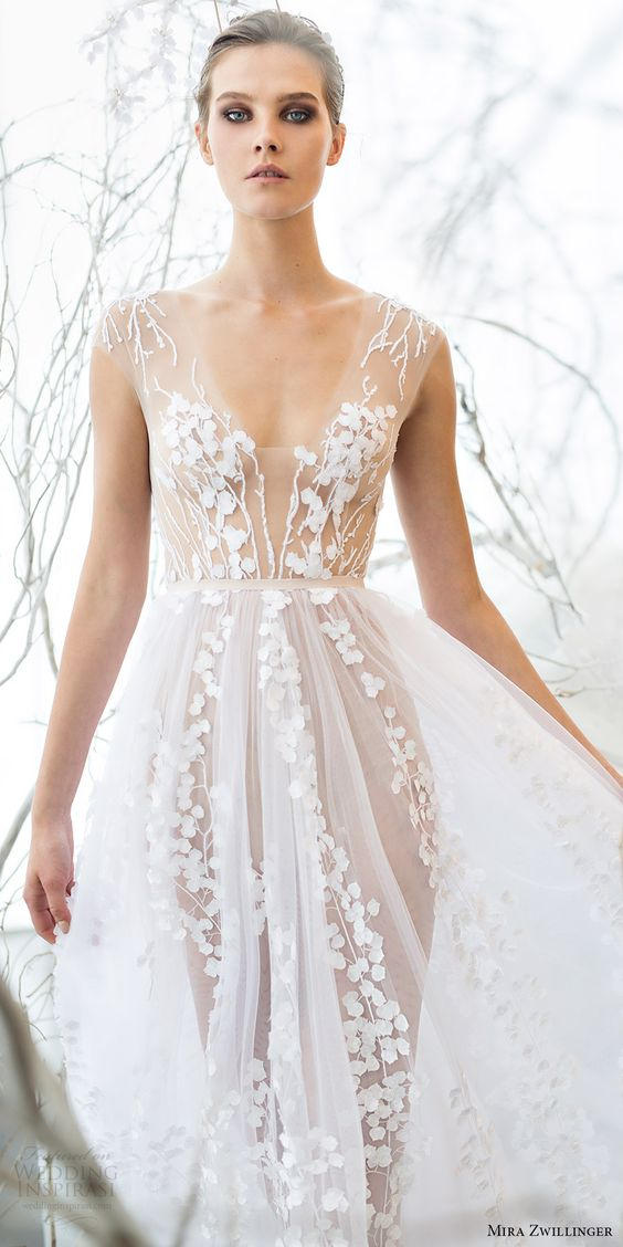ethereal blossom wedding dress with illusion parts