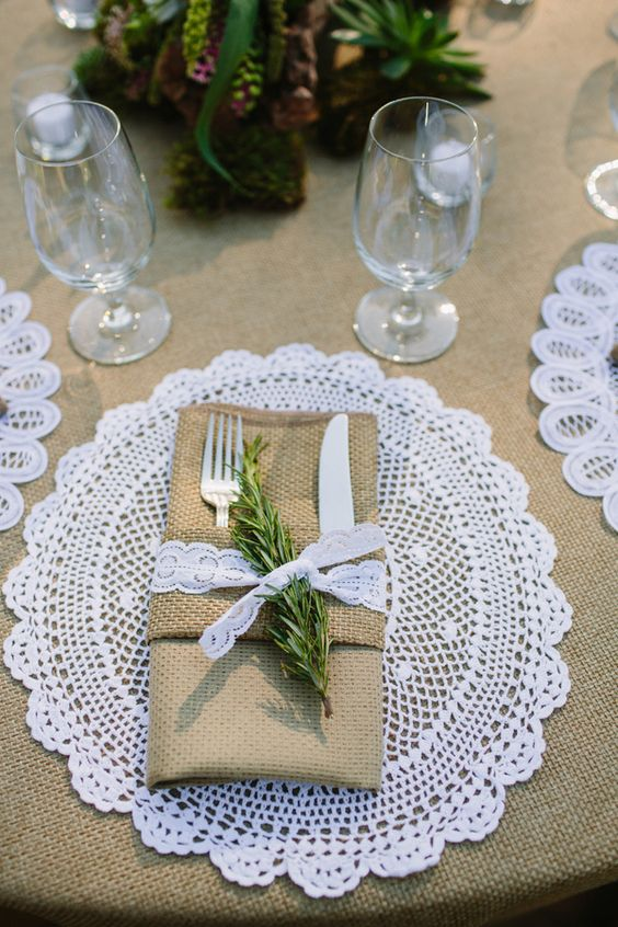 a crochet placemat perfectly fits this rustic table setting with burlap, lace and rosemary