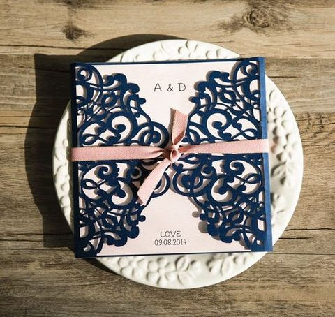 blush invitations and navy laser cut covers