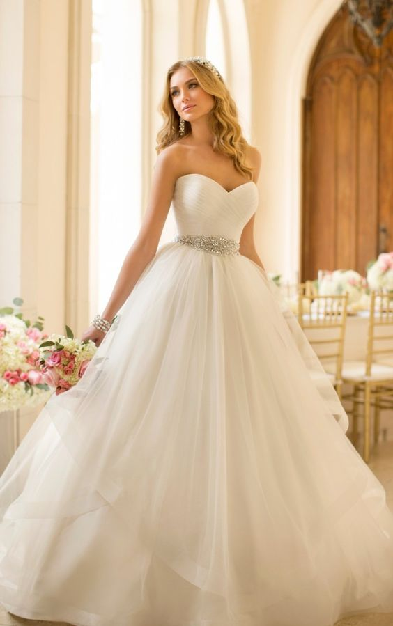 ruched bodice, an embellished sash and a layered tulle skirt