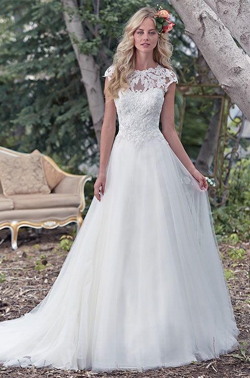 stunning illusion lace neckline takes center stage in this ball gown wedding dress, with enchanting lace bodice and flowing tulle skirt