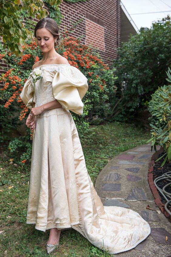 a bride wearing a 120-year-old dress from her family