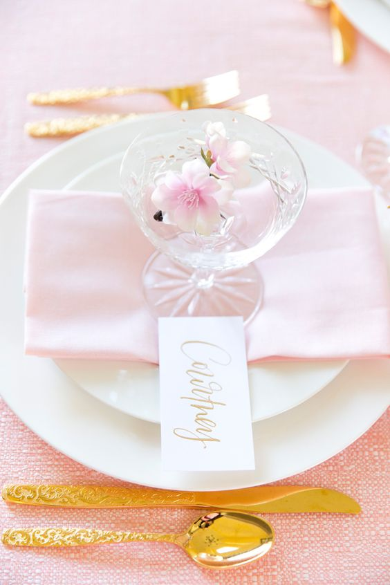 decorate your tablescape with blush napkins, cherry blossoms and gold tableware