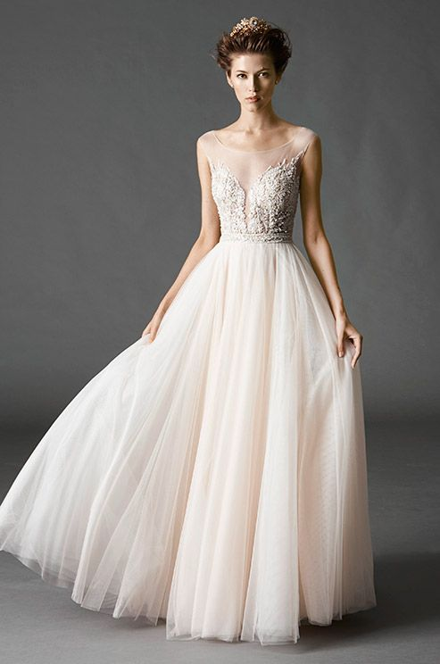 a beautiful light pink tulle wedding dress with an illusion neckline and a tulle skirt