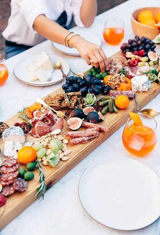 serving food at a boho picnic is a part of decor, make it creative and laid-back