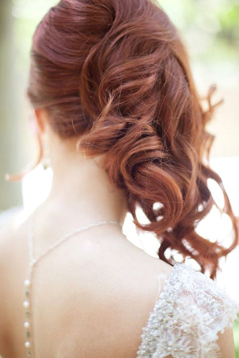 side swept curly ponytail