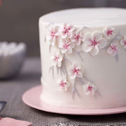 white one tier wedding cake with cherry blooms