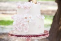 33 a blush wedding cake decorated with blossoms