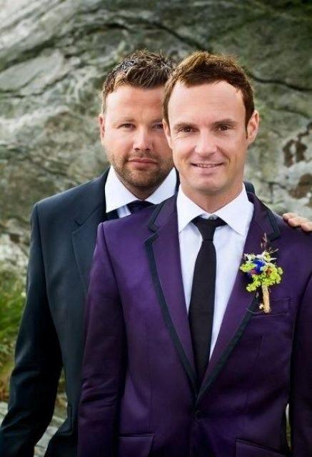 a bold purple suit and a black suit