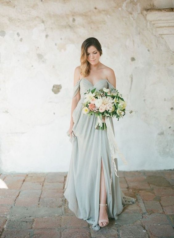 off the shoulder green bridesmaid's dress and a cute fresh bouquet