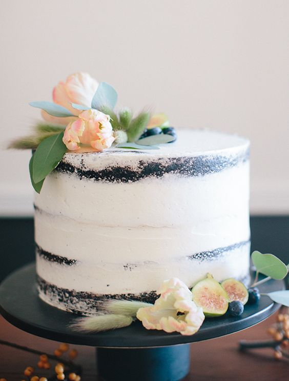 one-tier dirty icing wedding cake with berries and fruits