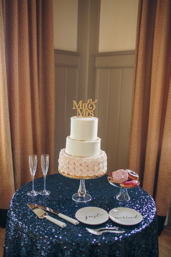 sequin tablecloth and a blush and ivory wedding cake