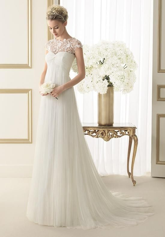 softly draped tulle sheath gown with empire waist and a sweetheart illusion neckline