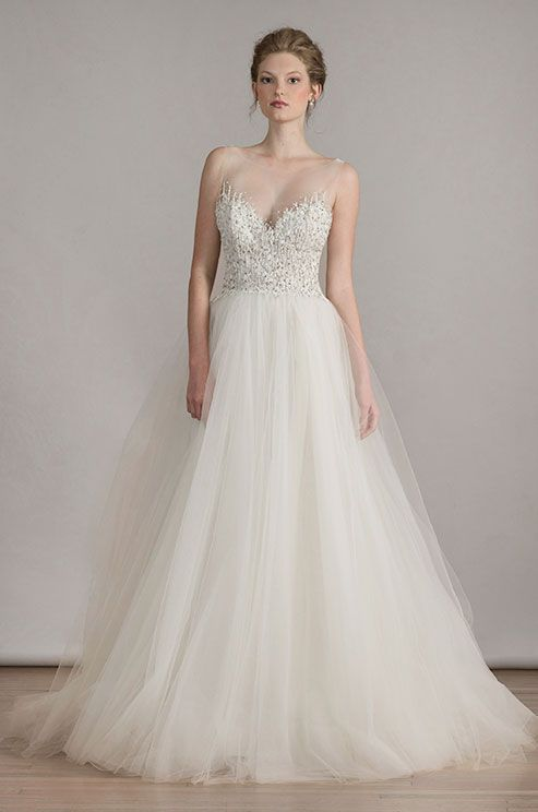 a beautiful ivory tulle wedding dress with illusion neckline