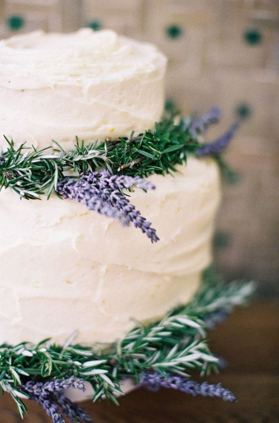 frosted wedding cake with rosemary and lavender