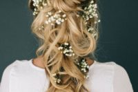 34 large curls pinned with baby's breath tucked into it