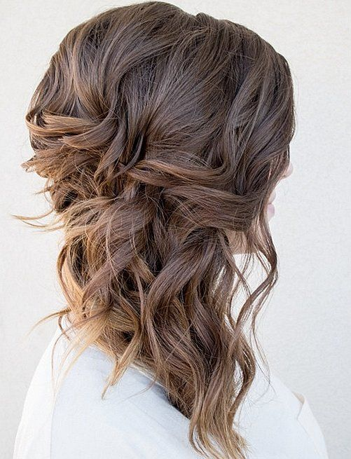 wavy and braided messy side swept hair