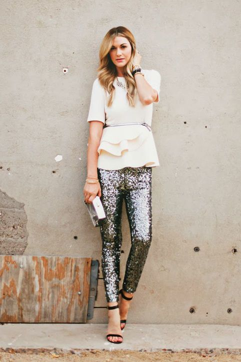 a peplum ivory top with a belt, sequin pants and heels