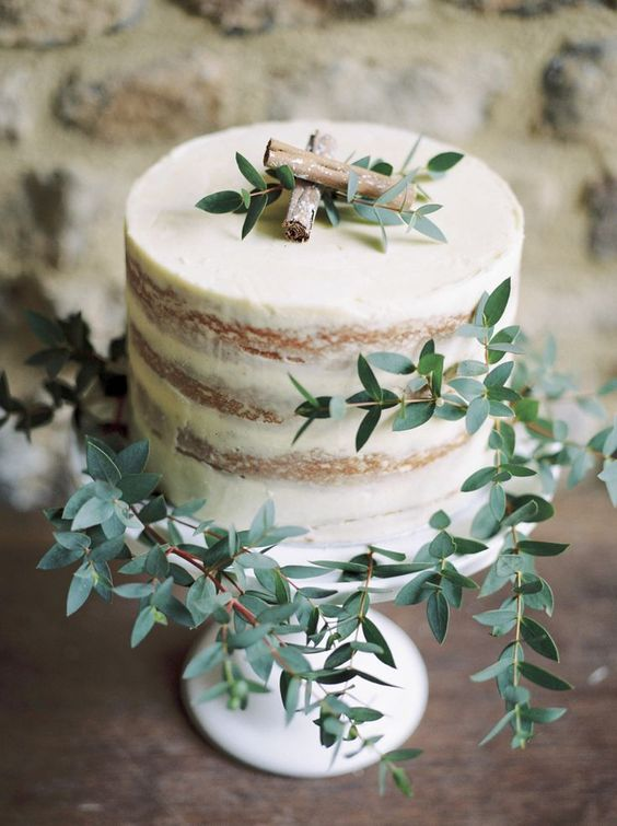36 elegant rustic wedding cake with cinnamon sticks and foliage