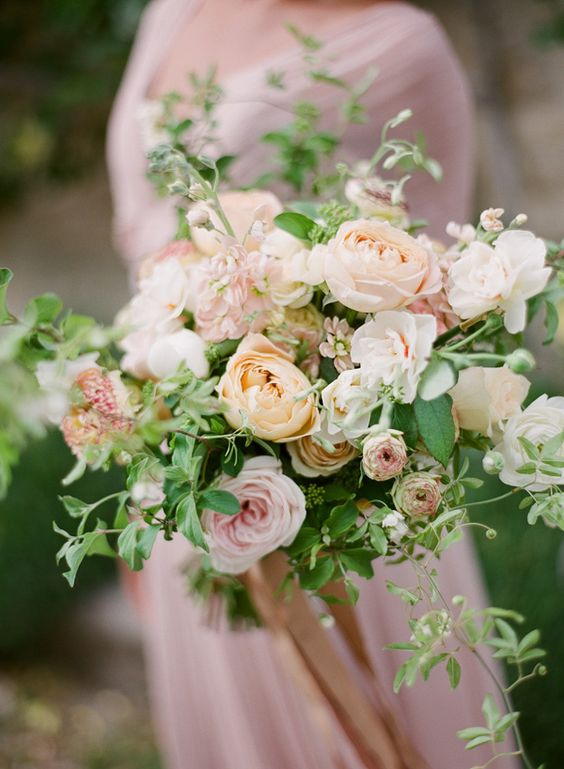 pastel peach bouquet is ideal for a spring garden bride